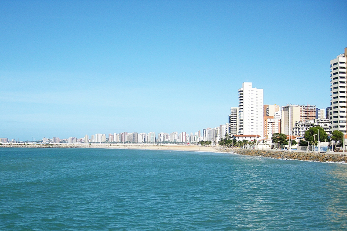 A view of the waterfront of Fortaleza, Brazil taken from a small boat in the harbor.