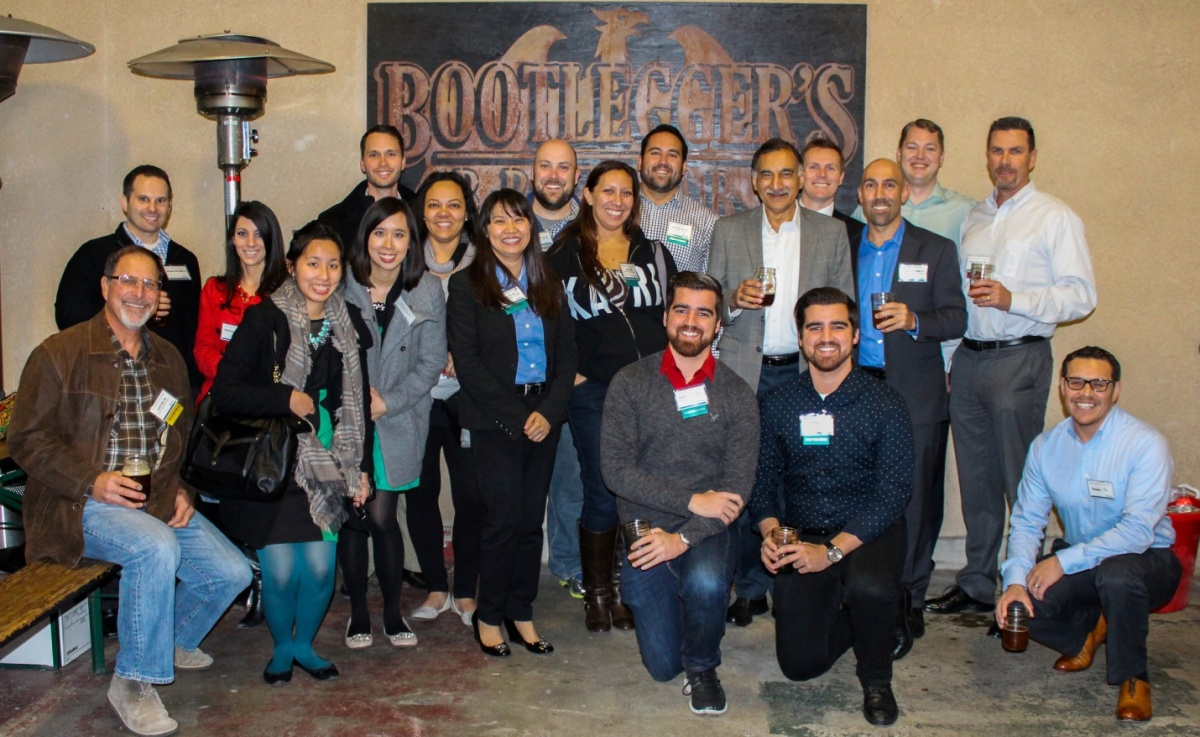 Friends and supporters of Mihaylo College pose at Bootlegger's Brewery in Fullerton, California, at the 35/Thirty-Five Holiday Toast, benefiting Working Wardrobes.