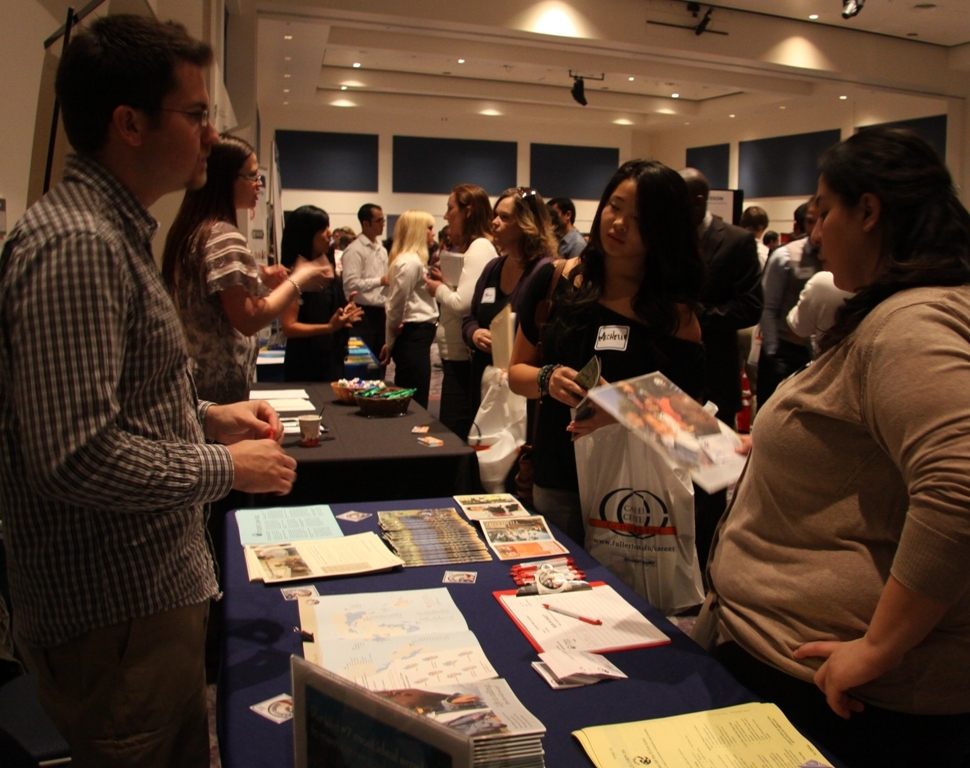 Cal State Fullerton students connect with company representatives at a career event in the Titan Student Union.