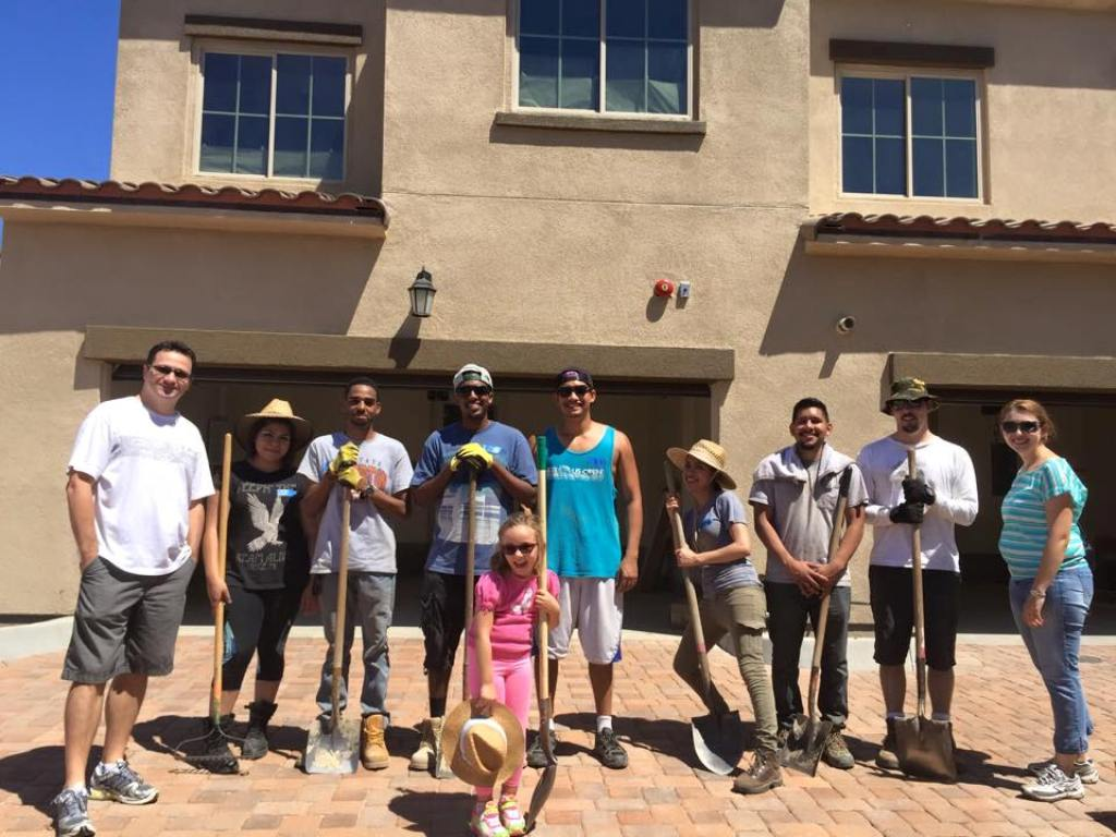 Mihaylo College grad Michael Willis and other volunteers at a home renovation project in La Habra, California.