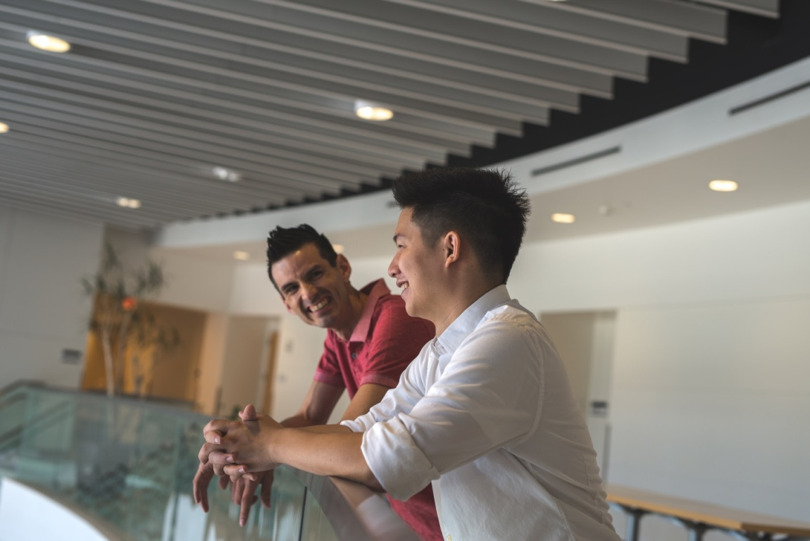 Business partners Ron Arellano (left) and Mihaylo College grad Jason Khoo'15, founders of Ron Wave Design (now known as Search Marketing Group) on the second floor of Steven G. Mihaylo Hall at Cal State Fullerton.