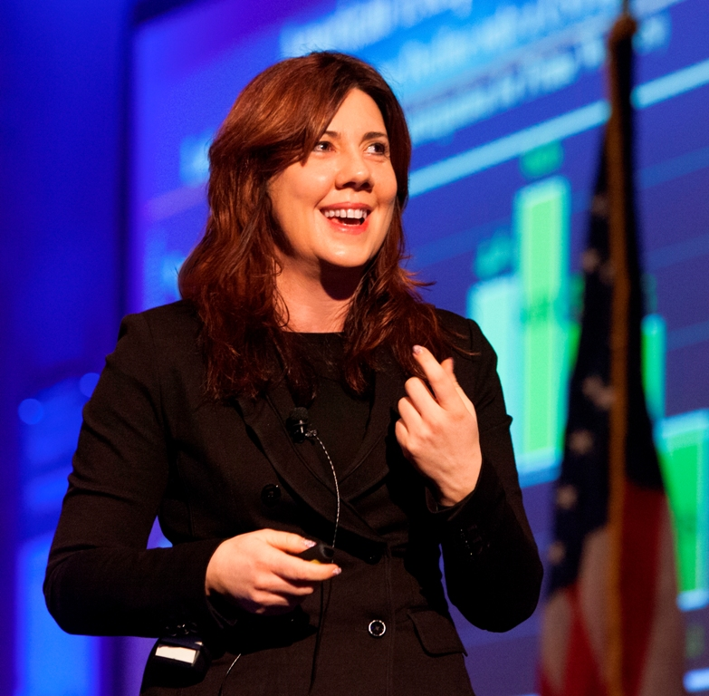 A smiling Mira Farka, Mihaylo College Associate Professor of Economics, discusses the outlook for the economy at the 2016 Midyear Economic Forecast.