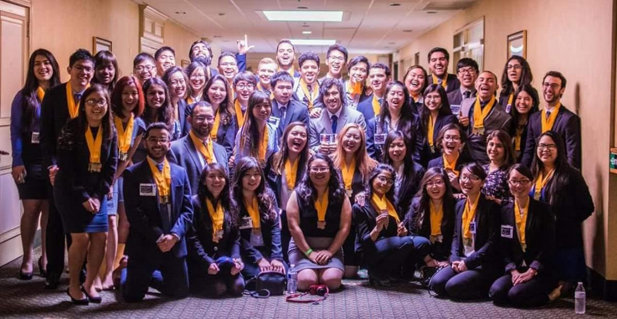 Cal State Fullerton Phi Beta Lambda students celebrate in the hallway at the spring 2016 conference in Union City, California.