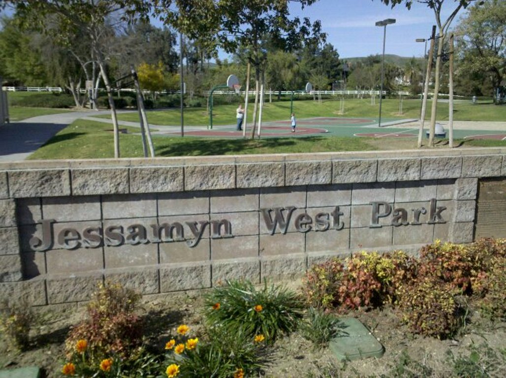 The sign and basketball court of Jessamyn West Park, a small city park, in Yorba Linda, California.