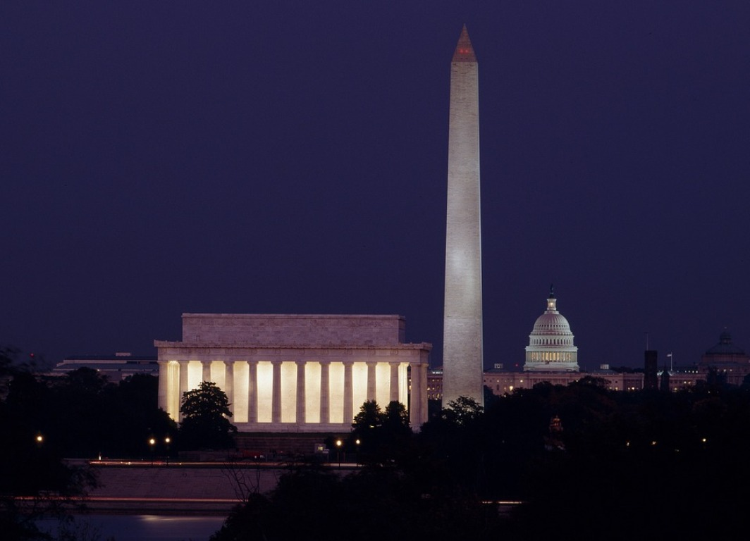 The Lincoln Memorial by night, with the Washington Monument and U.S. Capitol in the background.