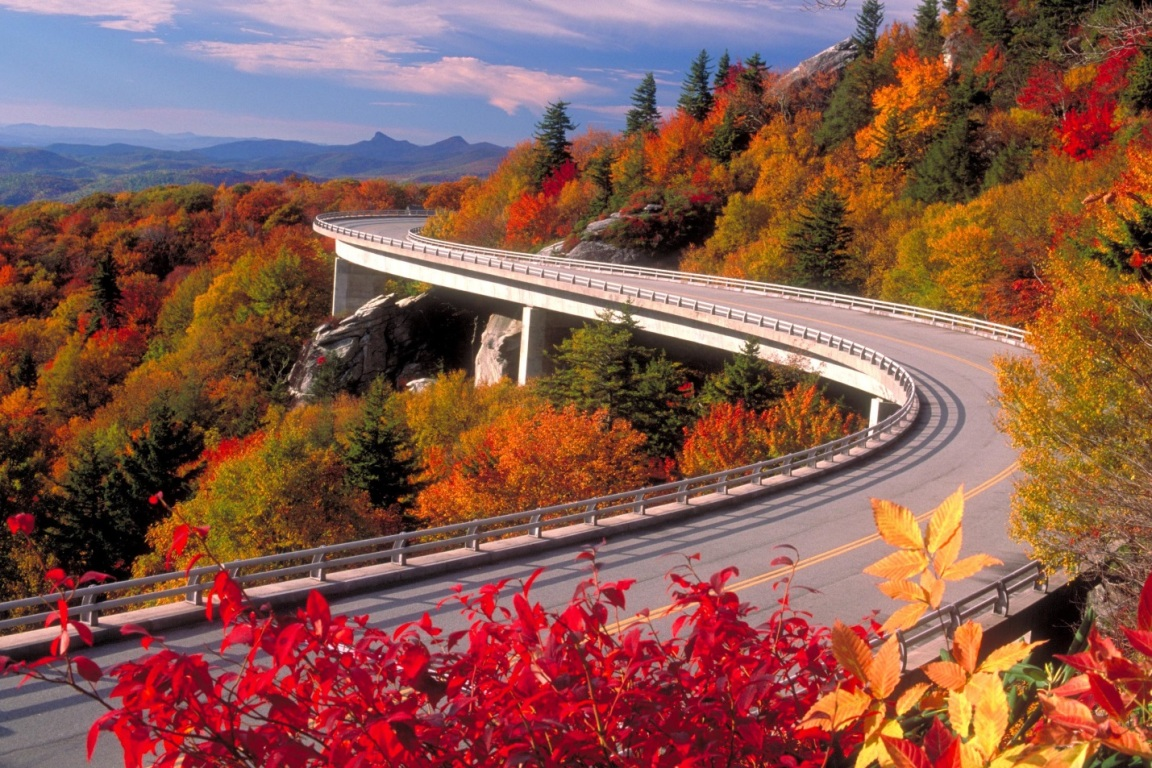 The Blue Ridge Parkway winds through the fall colors of the Appalachian Mountains.