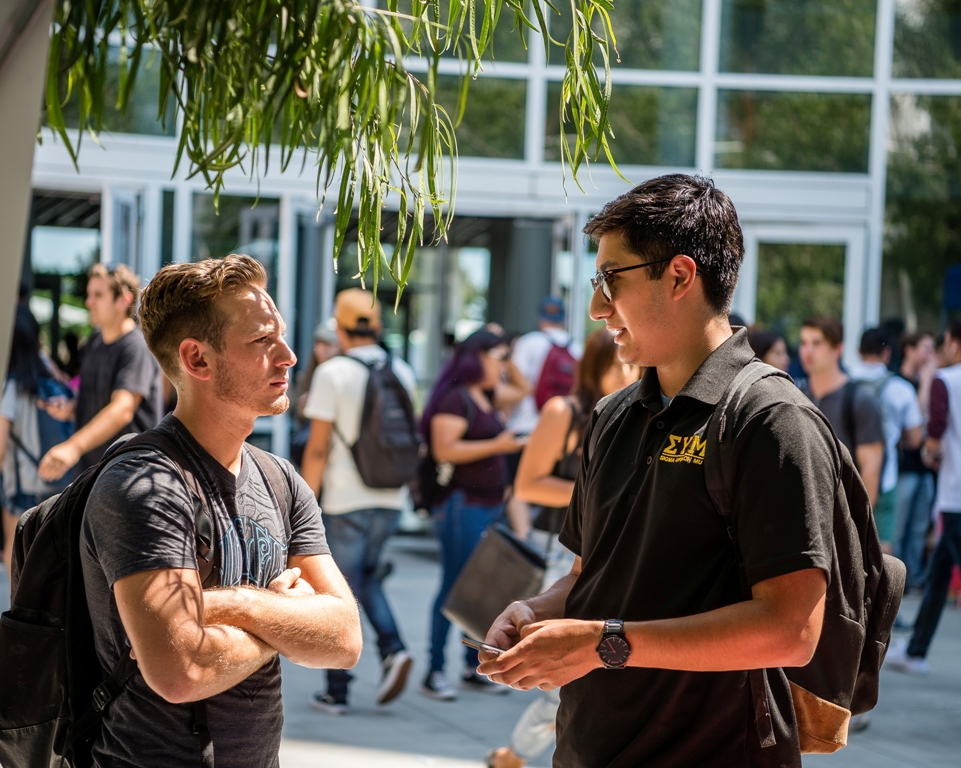 Representatives of Greek letter societies meet with Cal State Fullerton students in the Mihaylo Courtyard at the start of the semester.