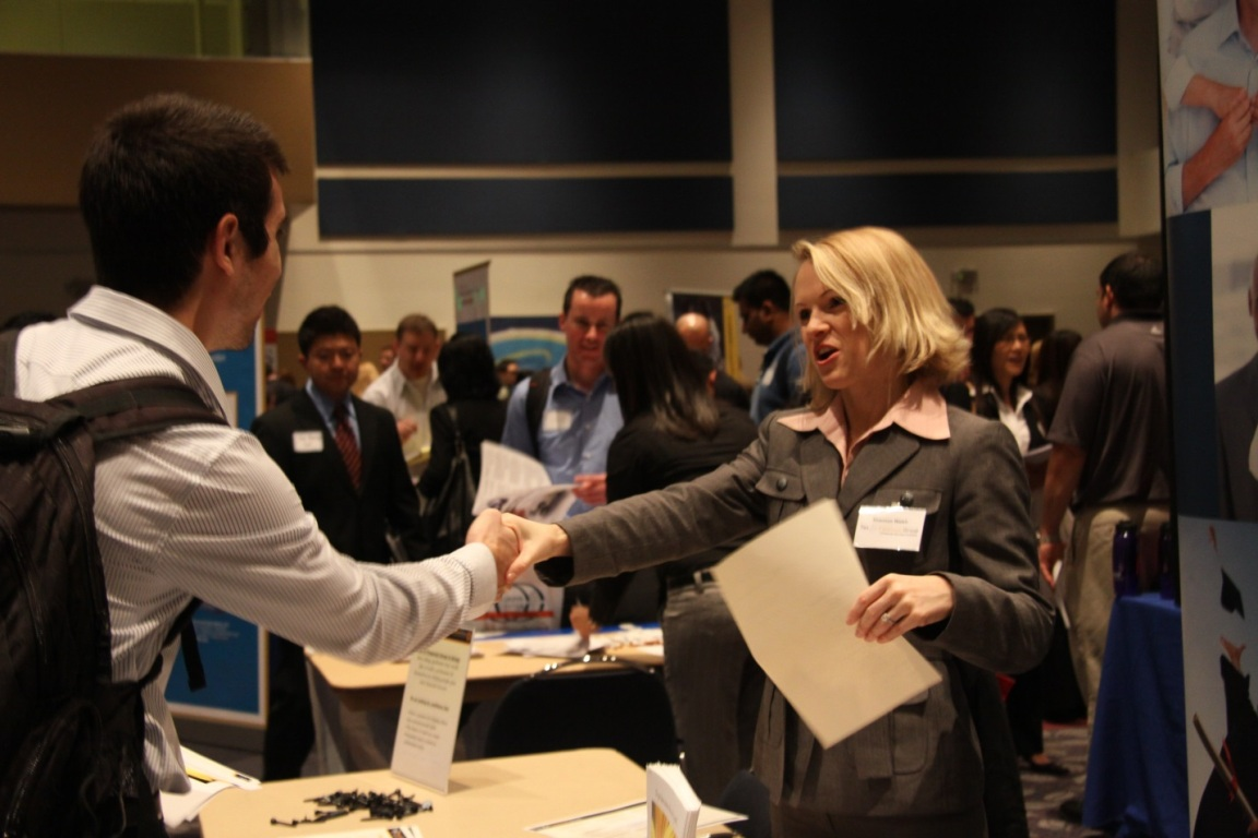 Cal State Fullerton students meet with company recruiters at a career fair held at the Titan Student Union.