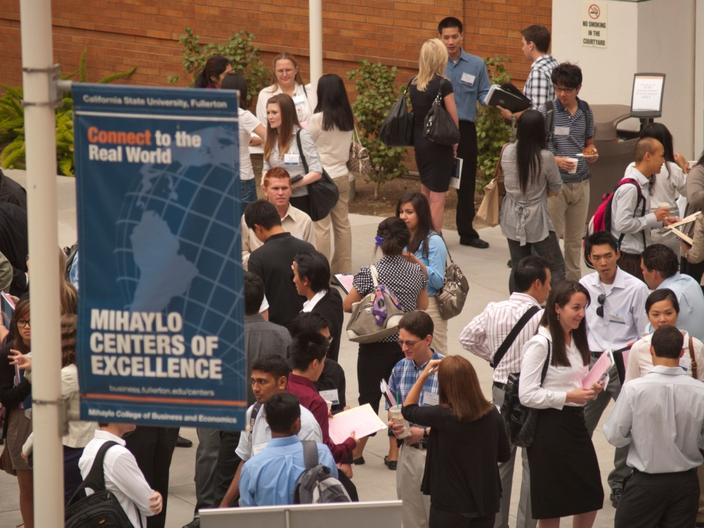 Mihaylo College graduate students network in the Steven G. Mihaylo Hall Courtyard at Cal State Fullerton.