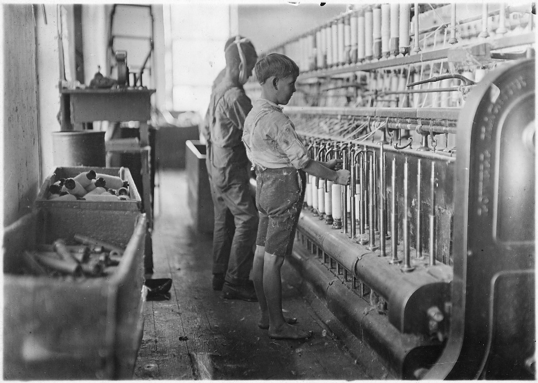 Several young boys working in a textile factory in North Carolina in the late 1800s or early 1900s.