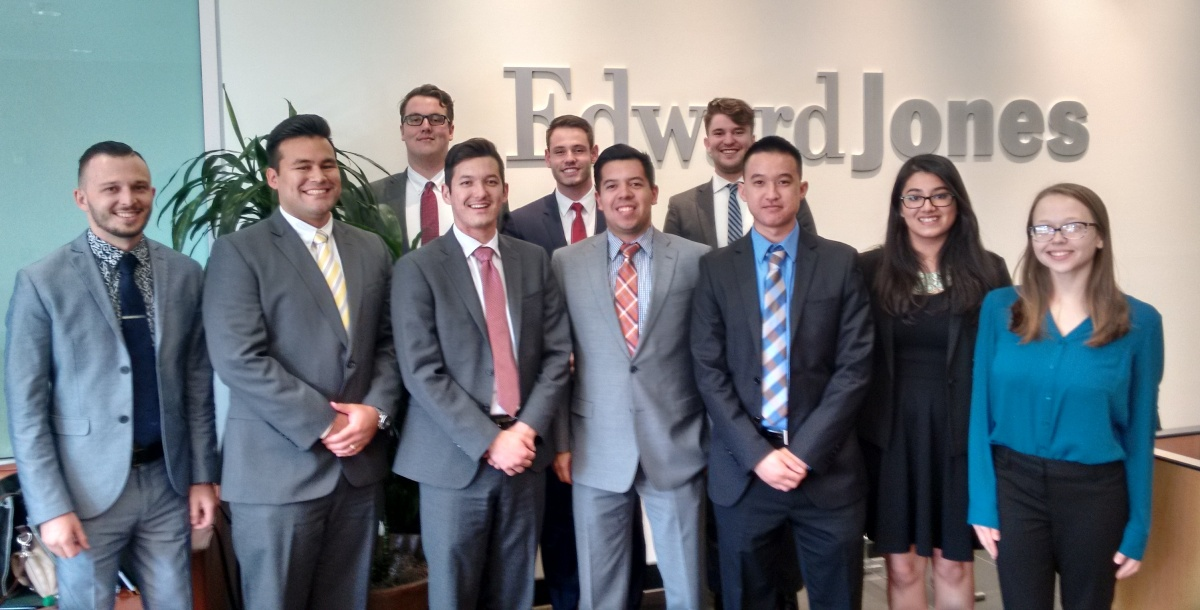 A group of 10 ASAP students pose in front of the Edwards Jones sign at a visit to the company's offices in Tempe, Arizona.