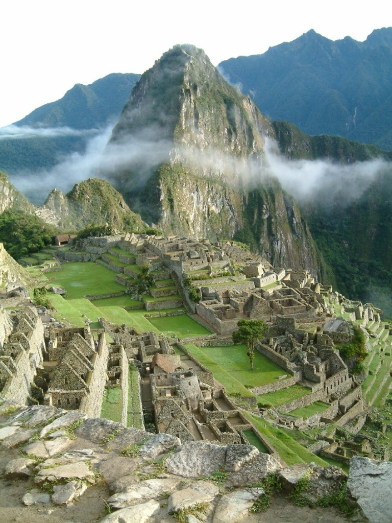 The ruins of the ancient hilltop city of Machu Picchu in the Andes Mountains in Peru.