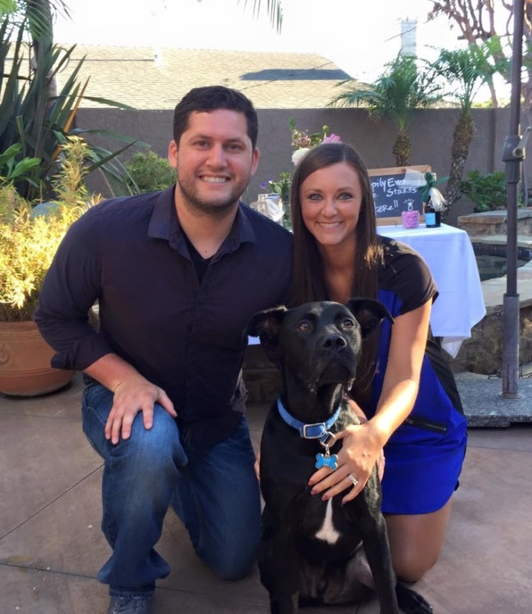 Matthew Sanchez, his wife and their dog pose in their backyard in Southern California.