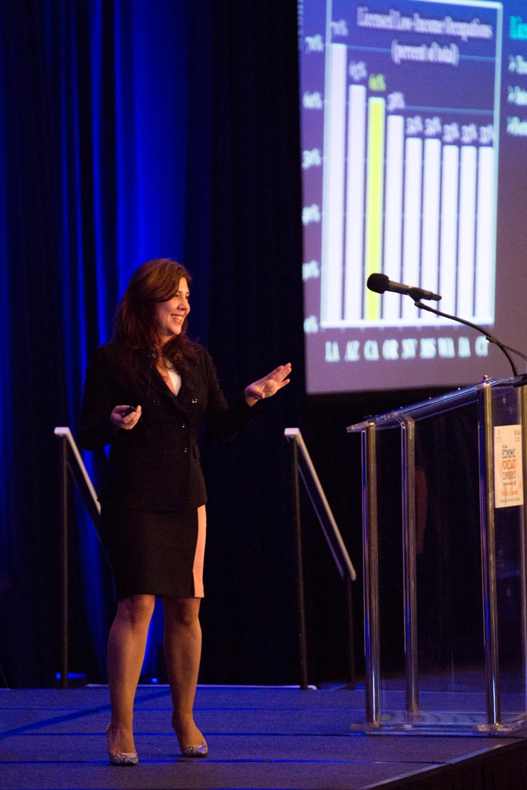 Mihaylo College Associate Professor of Economics Mira Farka discusses a graph showing unemployment rates at the Economic Forecast in 2016.