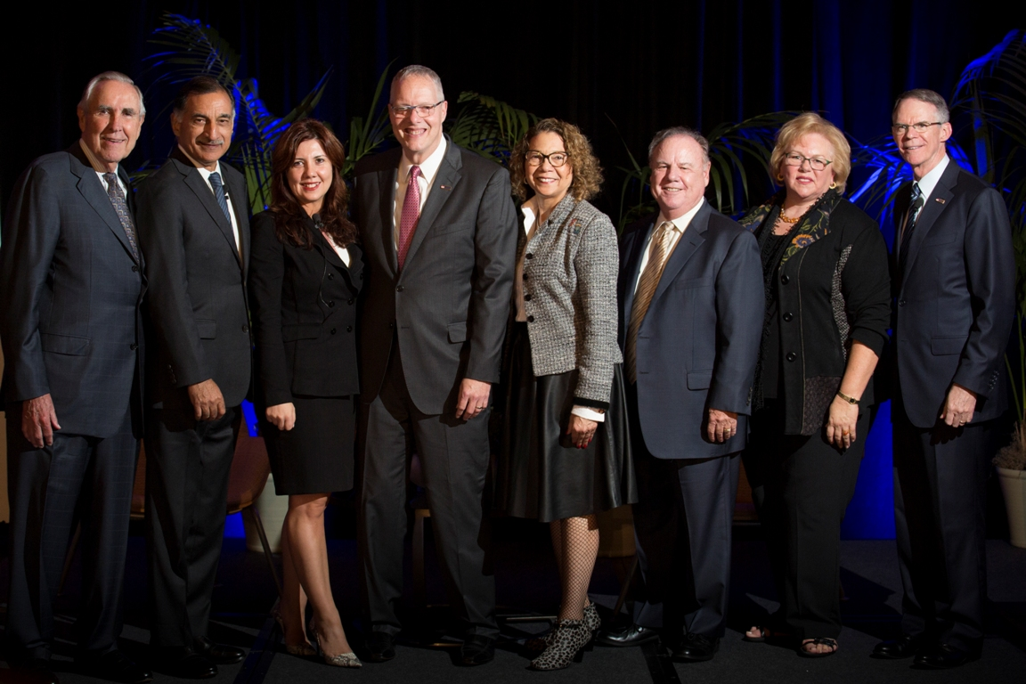 Mihaylo College Economic Forecast presenters Anil Puri and Mira Farka pose with business leaders, including keynote speaker and alumnus Richard Davis.