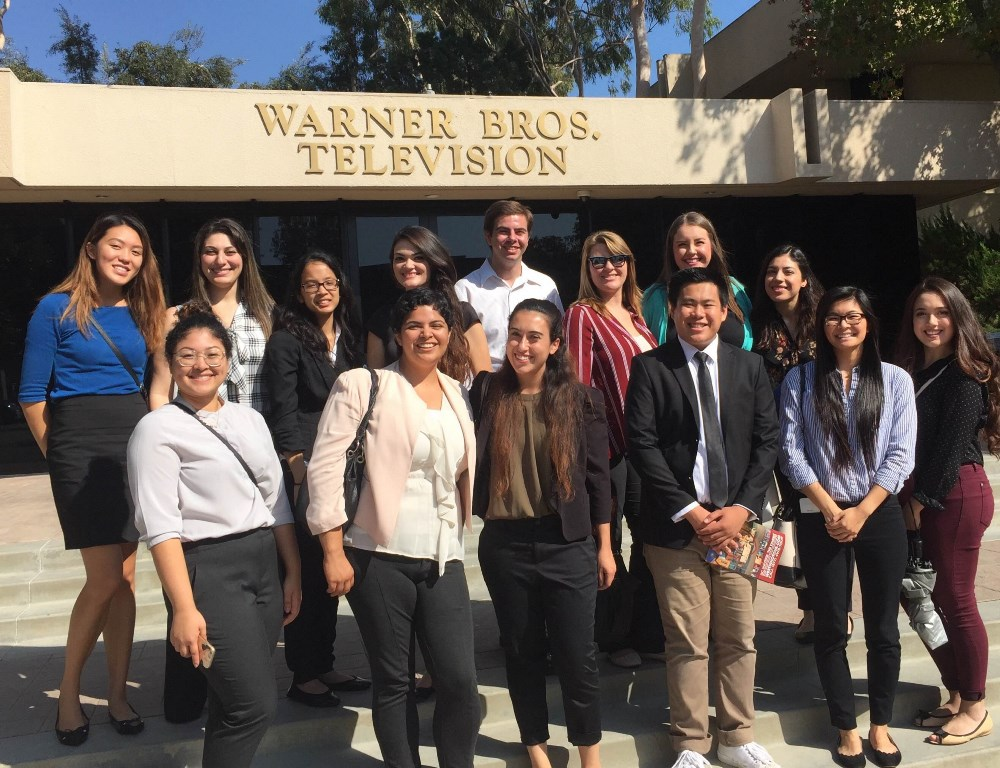 A diverse group of Mihaylo College students outside Warner Bros. Television near Los Angeles on a trip sponsored by the CSUF Behind the Scenes club.