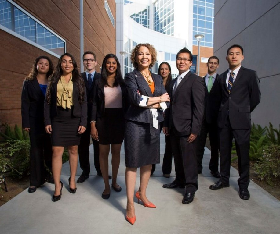Former CSUF President Mildred García poses with members of the business college community outside the Steven G. Mihaylo Hall in 2012.