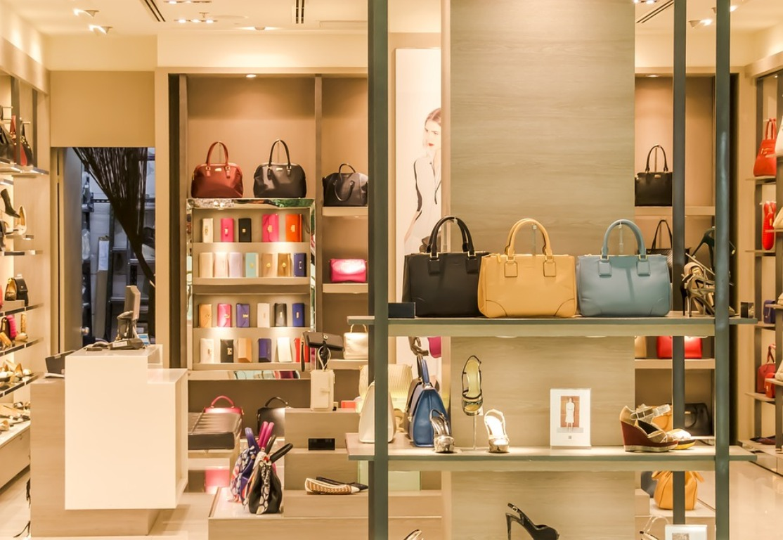 Handbags and accessories in a retail store.