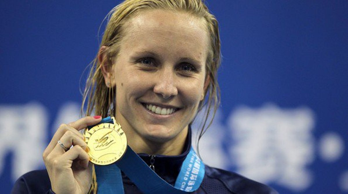 Olympic swimmer Jessica Hardy poses with a gold medal around her neck.