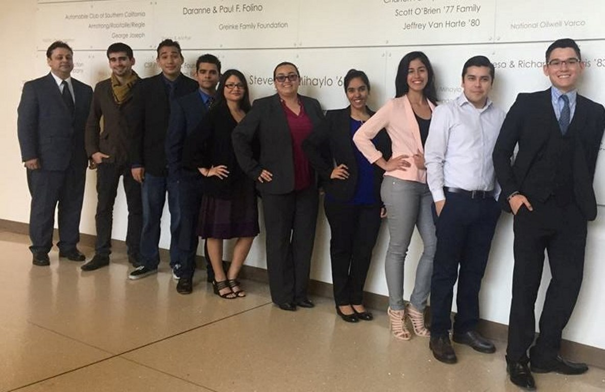 Student members of the Cal State Fullerton chapter of the Association of Latino Professionals for America (ALPFA) pose at Steven G. Mihaylo Hall.