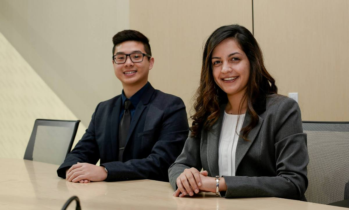 Vice President-elect Andrew La (left) and President-elect Laila Dadabhoy (right) in a professional pose at a desk soon after their election to the official CSUF student government in March 2017.