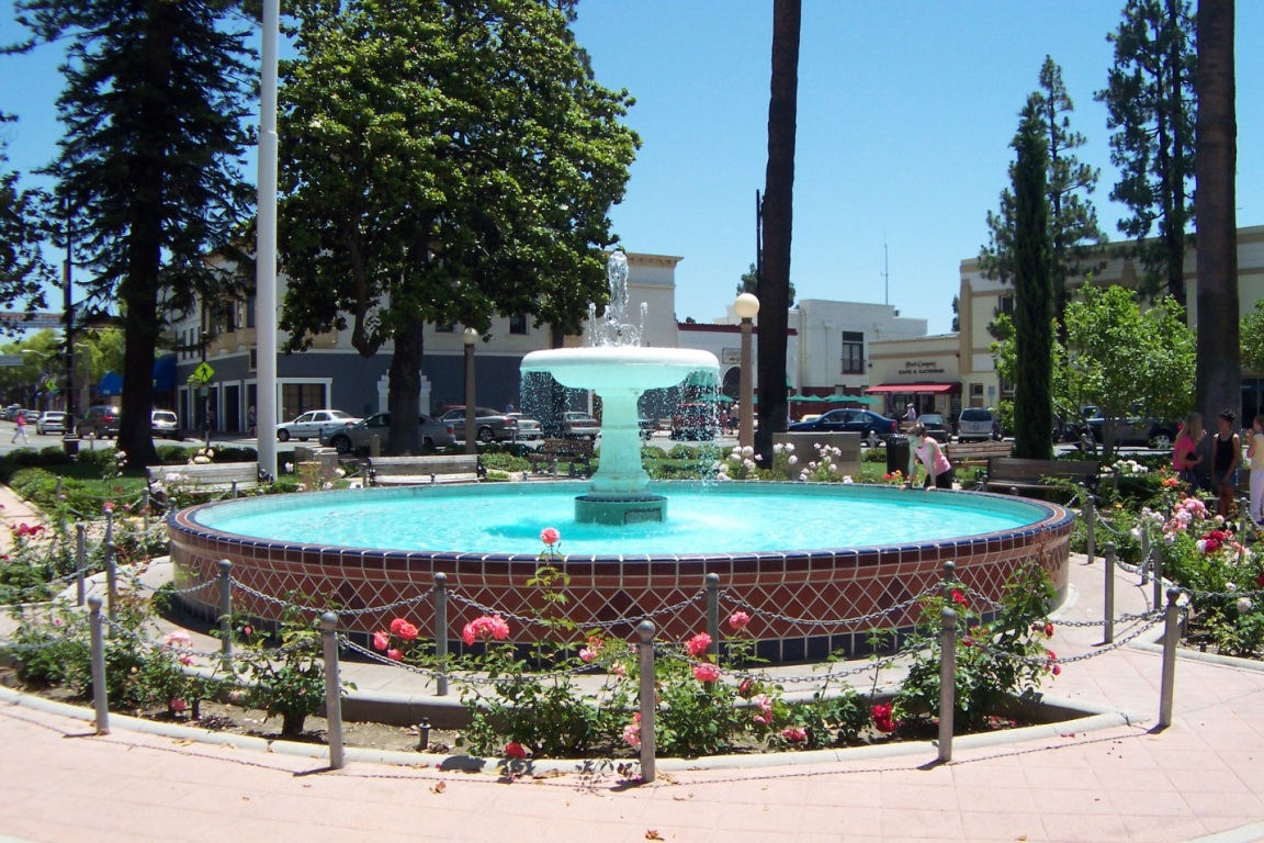 A fountain in the middle of the roundabout that forms the center of Old Towne Orange, California.