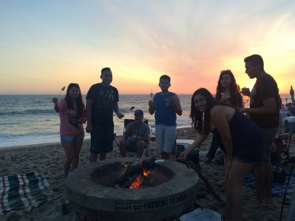 Student members of the Cal State Fullerton chapter of ALPFA at a beach bonfire near Laguna Beach, California.
