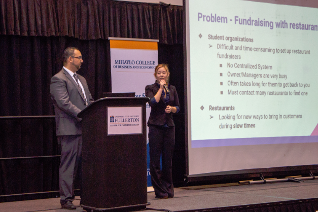Students present a business model presentation on stage at the 2016 Business Plan Competition at Cal State Fullerton.