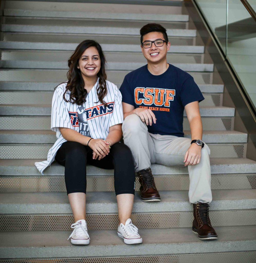 Laila Dadabhoy (left) and Andrew La (right) seated on the stairs of the Titan Student Union at Cal State Fullerton.