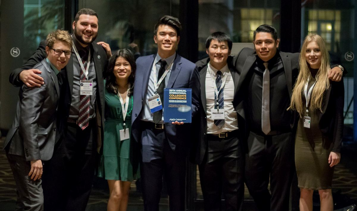 A group of Mihaylo College business students pose in professional attire at the AMA annual collegiate conference in New Orleans in 2017.