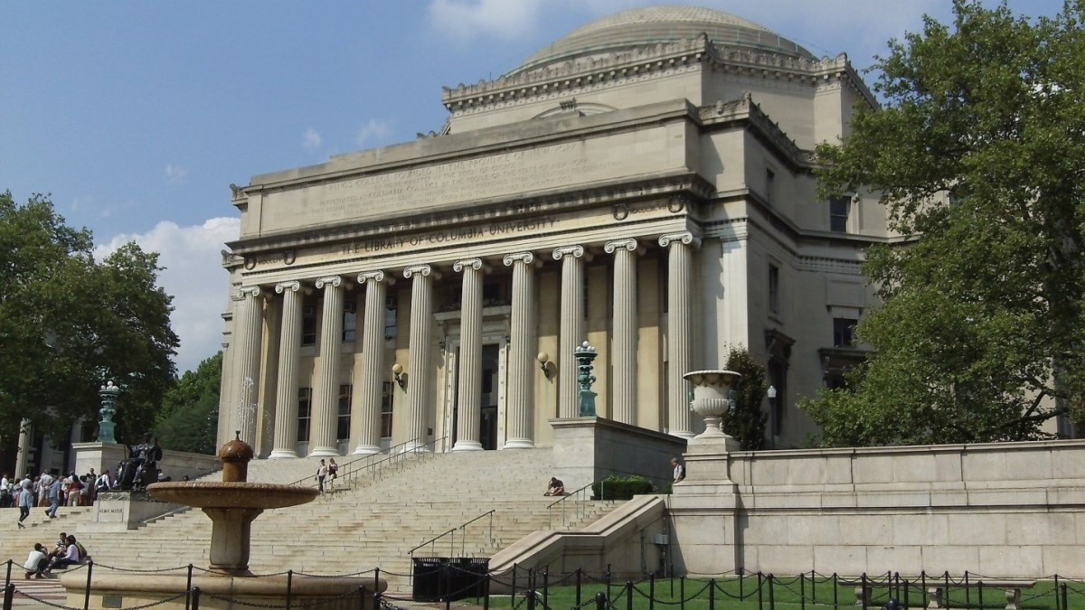 The columned exterior of a Greek revival building on the campus of Columbia University in New York City.