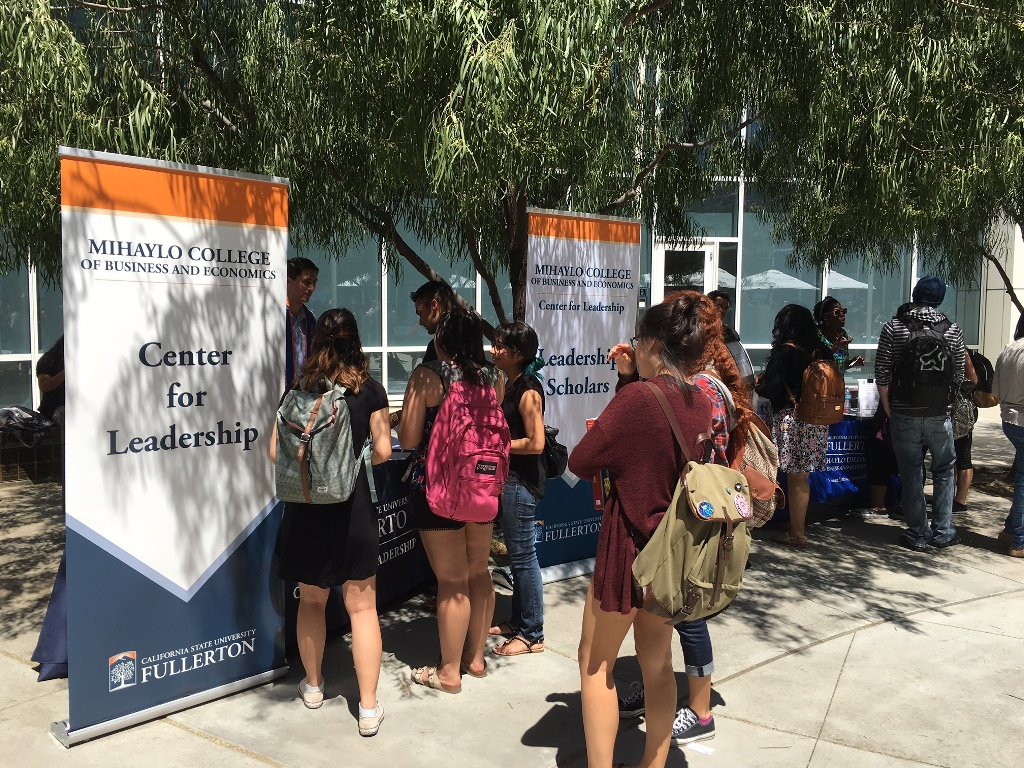 Mihaylo College students stand in line to learn about opportunities through the college's Centers of Excellence in the Mihaylo Courtyard.