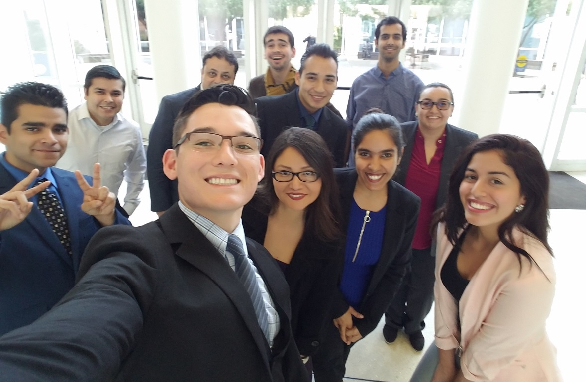 Smiling, mostly Hispanic, students in the lobby of Steven G. Mihaylo Hall of Cal State Fullerton.