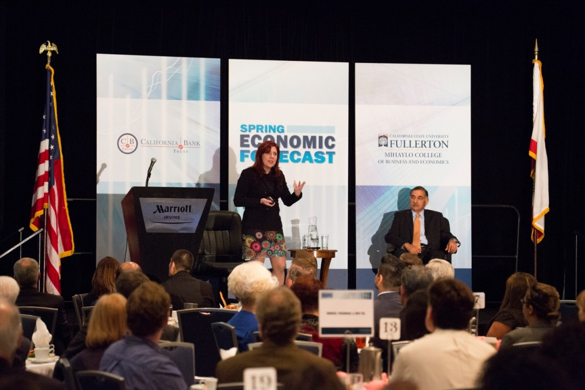 Mihaylo Associate Professor of Economics Mira Farka speaks to Orange County business leaders at the Midyear Economic Forecast in spring 2017.