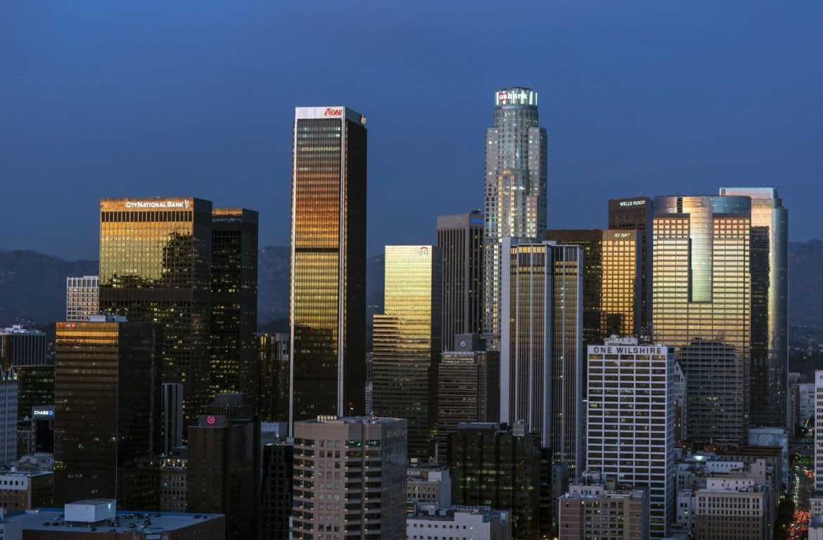 The skyline of Downtown Los Angeles at sunset.