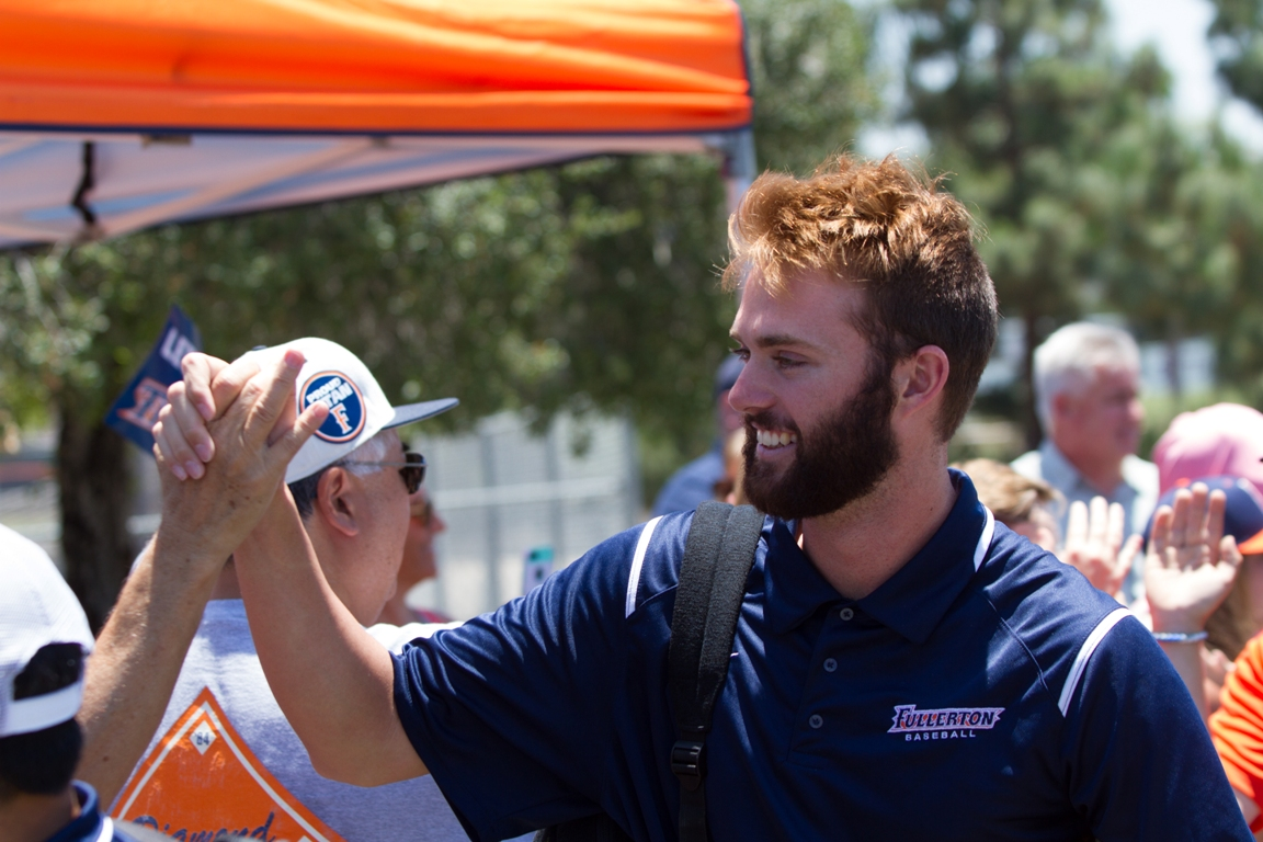 Members of the 2017 Cal State Fullerton baseball team greet fans upon their return from the College World Series.