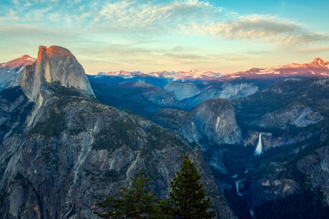 A panoramic view of the striking domes and waterfalls of California's Yosemite National Park.