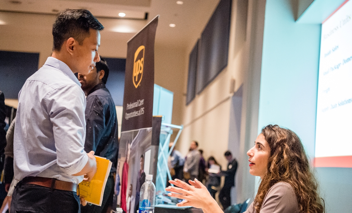 A Mihaylo College student talks with a recruiter at a job fair at Cal State Fullerton.