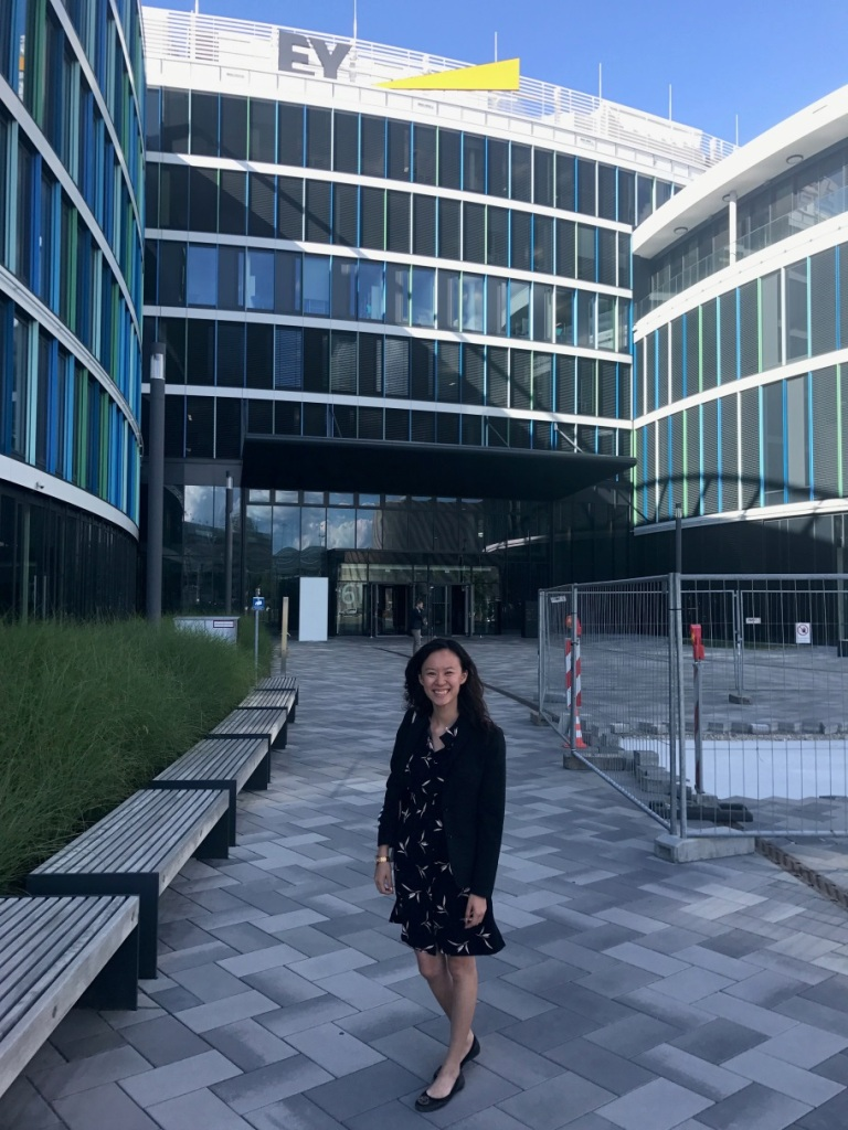 Mihaylo College Finance student Ada Fu poses in front of the EY building in Germany where she interned in summer 2017.