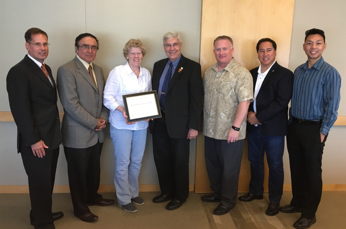 Mihaylo College leaders and industry professionals finalize the details of a new scholarship for Cal State Fullerton business students.