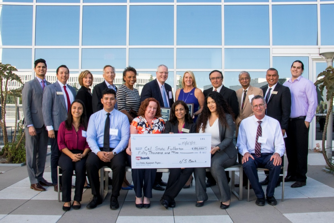 U.S. Bank presents a generous gift to fund Mihaylo College's Center for Economic Education outreach to impart financial literacy to Southern California schoolchildren.