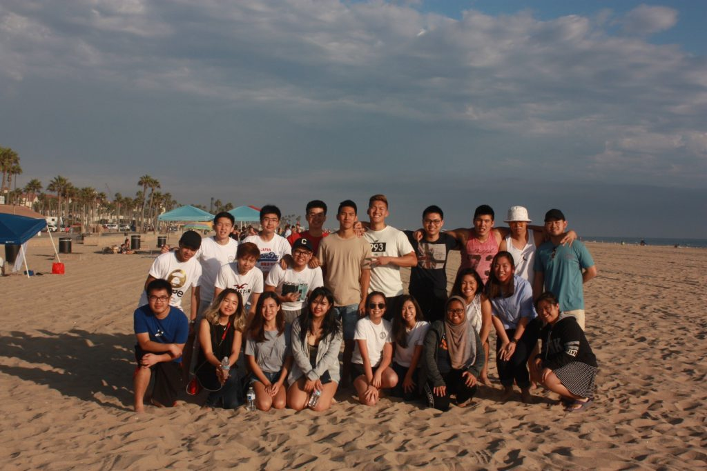Students in the CSUF Association of Indonesian Students club at an Orange County beach.