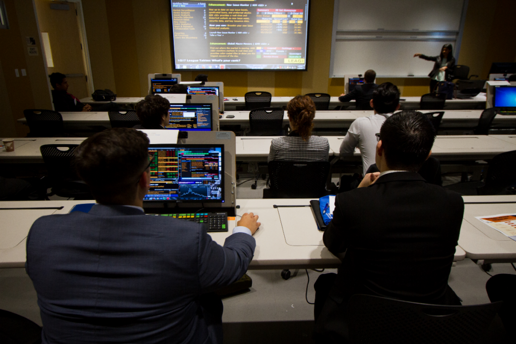 Mihaylo College students work on an investment project at the Titan Capital Management lab in Cal State Fullerton's Steven G. Mihaylo Hall.