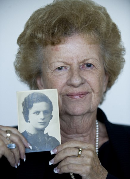 Irene Lange, Mihaylo College marketing professor, holds up a grayscale photo of her mother, Elena, from the 1930s.