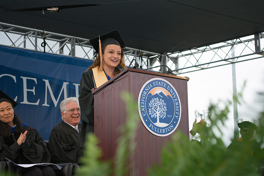 Mihaylo College grad Rachel Herzog '18 sings a humorous rap song at Cal State Fullerton's business college commencement on May 19, 2018.