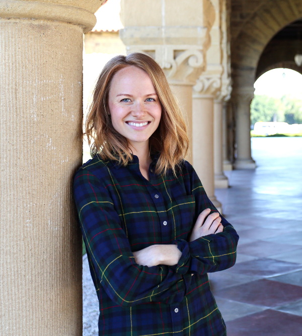Taryn Moore, a Cal State Fullerton international business grad, poses in the hallways of Stanford University in Palo Alto, California, where she received her master's degree.