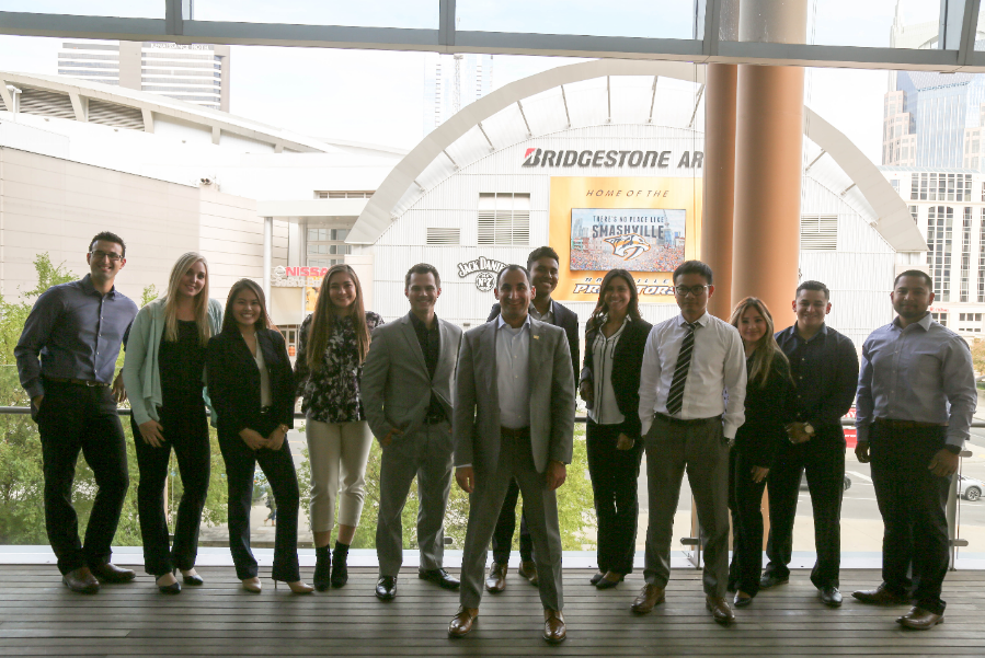 Mihaylo College Finance Professor David Nanigian stands in front of a group of CSUF personal finance students at the Bridgestone Arena in Nashville, Tennessee, site of the 2017 Financial Planning Association Conference.