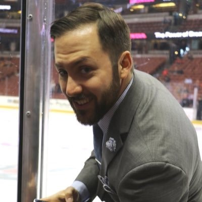 A.J. Manderichio, social media manager for the Anaheim Ducks, watches a game at the Honda Center.