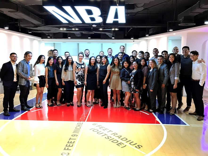 Mihaylo College students and Professor Lorenzo Bizzi at the National Basketball Association (NBA) headquarters in China during the Mihaylo College study tour in 2018.