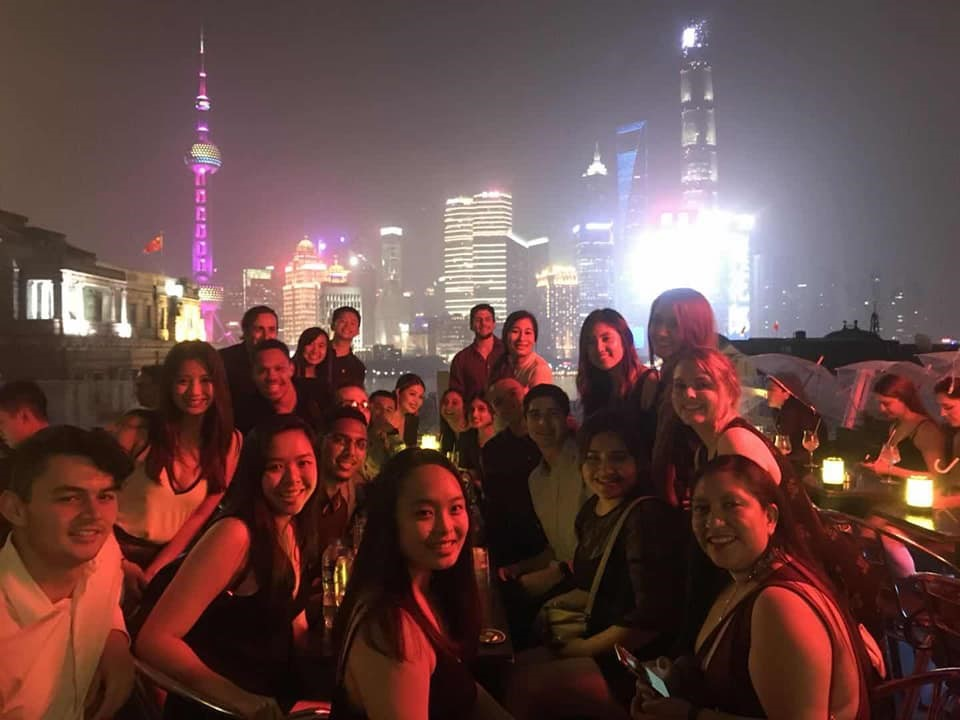 Mihaylo College students pose on the Shanghai waterfront by night during a study tour in China in 2018.